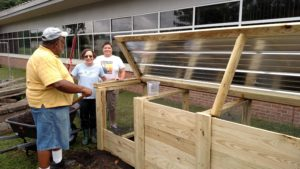 Extension Master Gardener Volunteers working on compost bin
