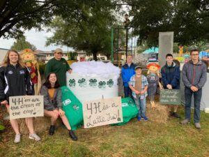"Pender County 4-H members with their ""4-H is a LATTE fun"" hay bale display at the 2019 NC State Fair"