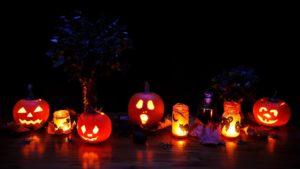 carved pumpkins lit up at night